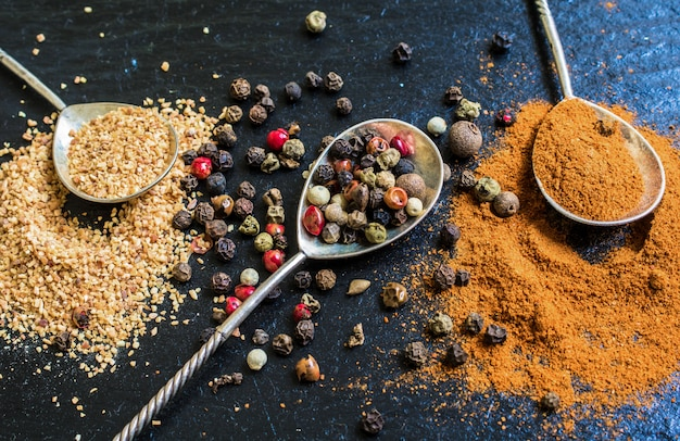 Peper spices on stone background