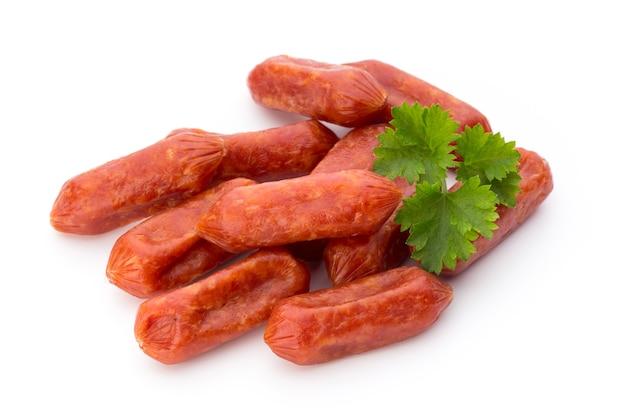Peperoni or salami, parsley sausage isolated on white.