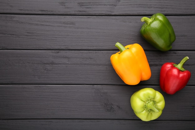 Pepper on a black background. colorful paprika on wooden background.
