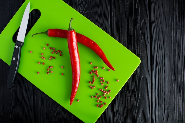 Pepper chile on the green cutting board top view