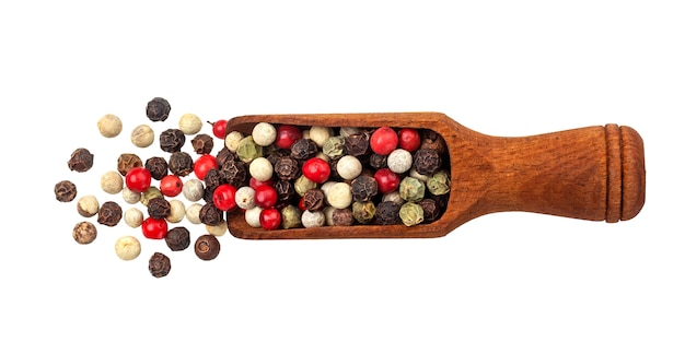 Pepper mix. black, red, white and allspice peppercorns in scoop isolated