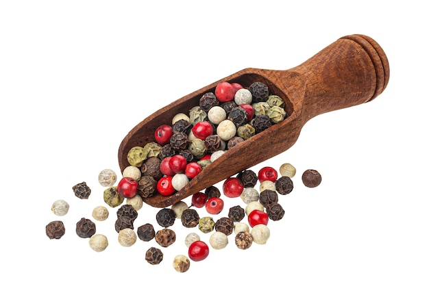 Pepper mix, peppercorns in scoop isolated on white background