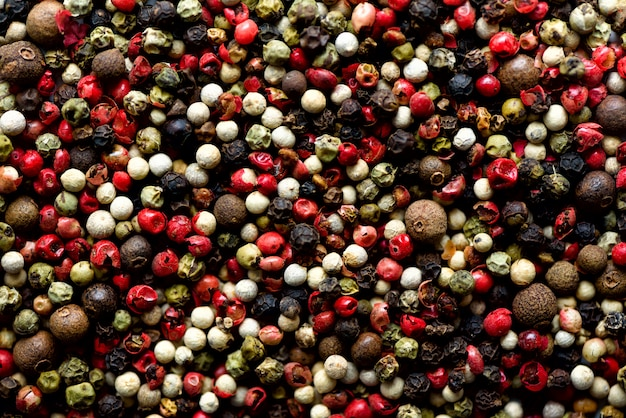 Pepper spice texture. multicolored pepper corns, mix of colorful grains. ingredients for cooking, top view