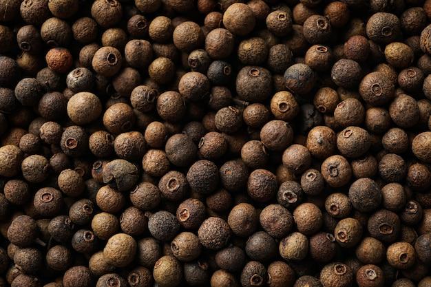 Peppercorns texture, close up. wallpaper for design