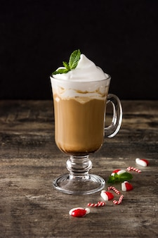 Peppermint coffee mocha for christmas on wood table and black