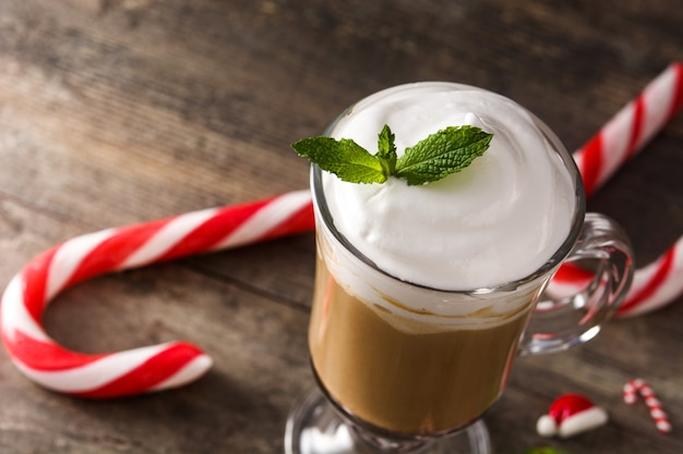 Peppermint coffee mocha for christmas on wood table copy space