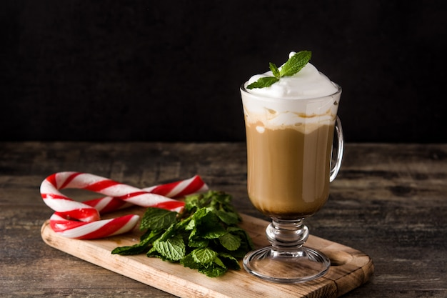 Peppermint coffee mocha for christmas on wooden table