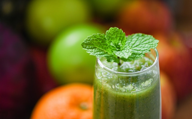 Peppermint tea green mint leaf on fresh vegetable juice smoothie and summer fruit