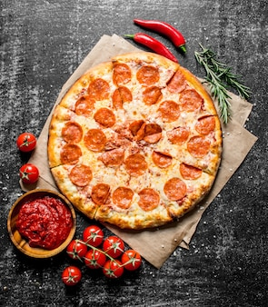 Pepperoni pizza with chili, rosemary and tomatoes.