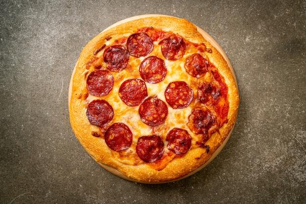Pepperoni pizza on wood tray - italian food style