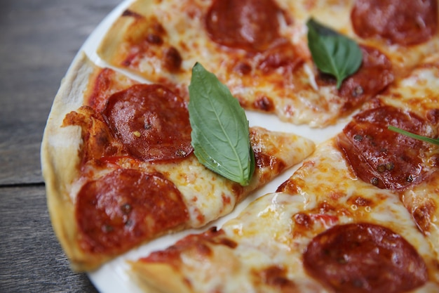 Pepperoni pizza on wood
