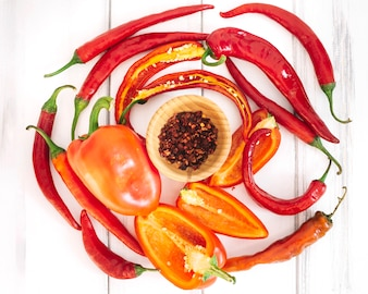 Peppers and wooden bowl