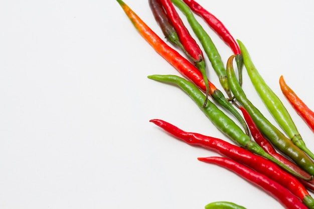 Peppers on plain background with copy-space