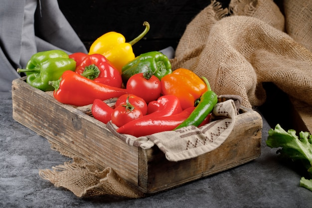 Peppers in a wooden container.