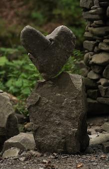 Perfect balanced broken heart shape rocks outdoors