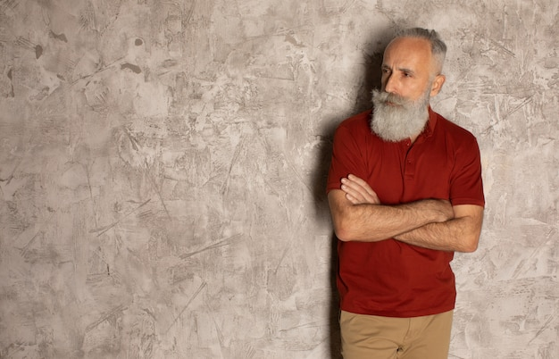 Perfect beard. close-up of senior bearded man standing against grey background