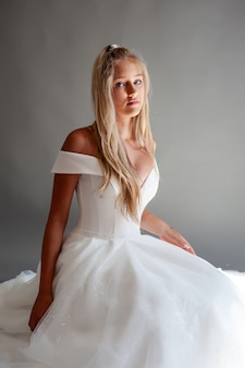 Perfect bride portrait of a girl in a long white dress