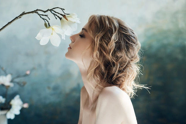 Perfect bride, portrait of a girl in a long white dress.