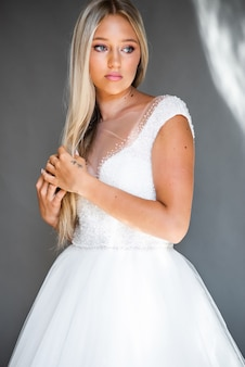 Perfect fashion model woman with beautiful hairstyle prom or bride girl