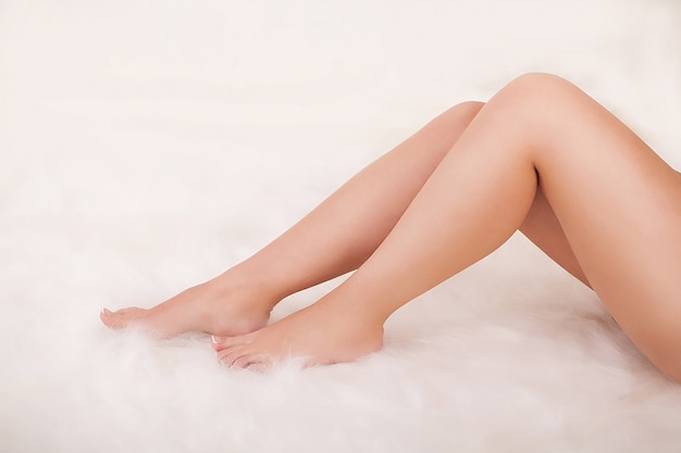 Perfect female legs isolated on white