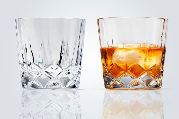 Perfect glasses of whiskey and ice isolated