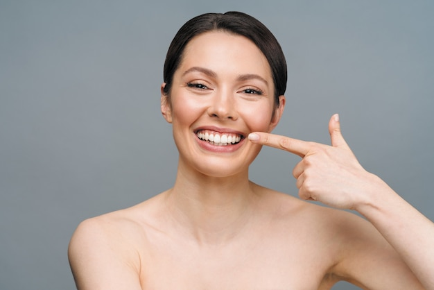 Perfect healthy teeth smile of a young woman teeth whitening dental clinic patient image symbolizes