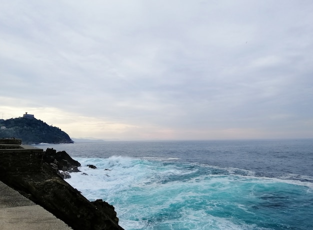 Perfect scenery of a tropical beach in san sebastian resort town, spain