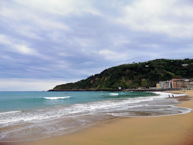 Perfect scenery of a tropical beach in san sebastian resort town, spain