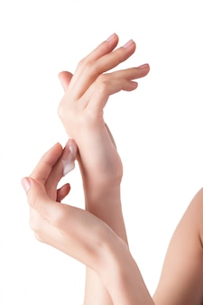 Perfect soft hands on with the drop of moisturizing cream on. young girl wearing hand cream