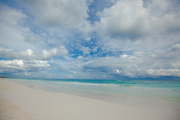 Perfect tropical beach with turquoise water and white sand beaches in tulum, mexico