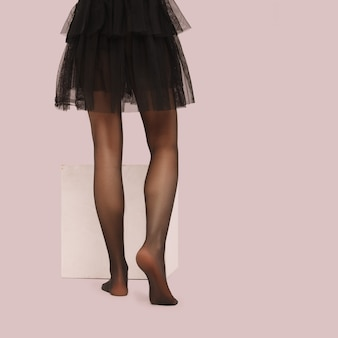 Perfect woman's legs in pantyhose back view