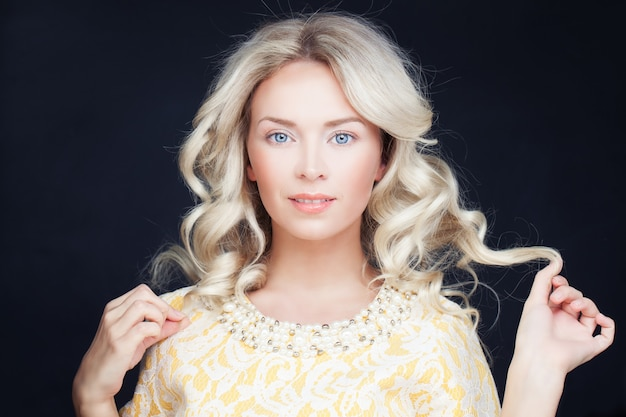 Perfect woman with blonde curly hair. wavy hairstyle