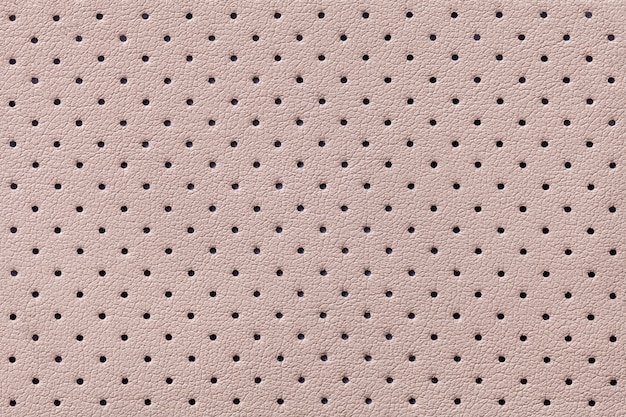 Perforated beige leather texture background,  light brown backdrop from wrinkle skin,