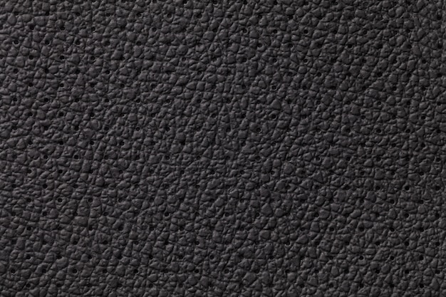 Perforated black leather texture background