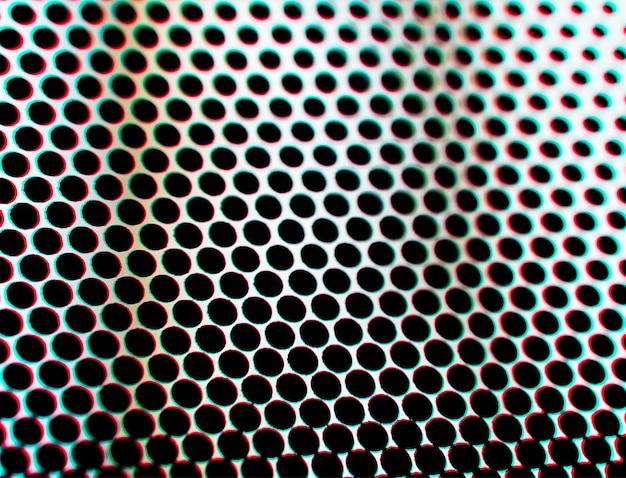 Перфорированная металлическая поверхность с фоном текстуры хроматической аберрации