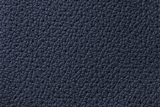 Perforated navy blue leather texture background