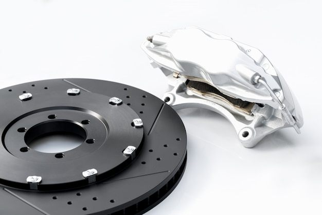 Performance braking system, new silver caliper and new perforated disk.