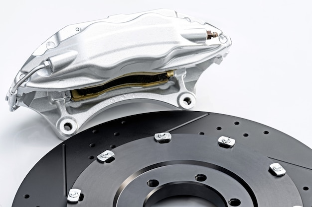 Performance braking system, silver caliper and new perforated disk.