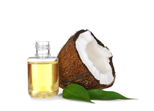 白地に香水瓶とココナッツ Premium写真
