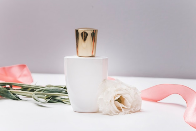 Perfume bottle on a background of flowers