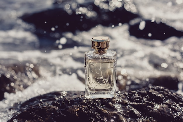 Perfume bottle on blue sea background