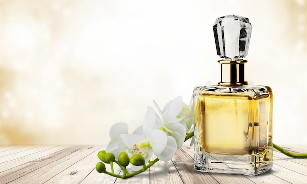 Perfume bottle and flowers .