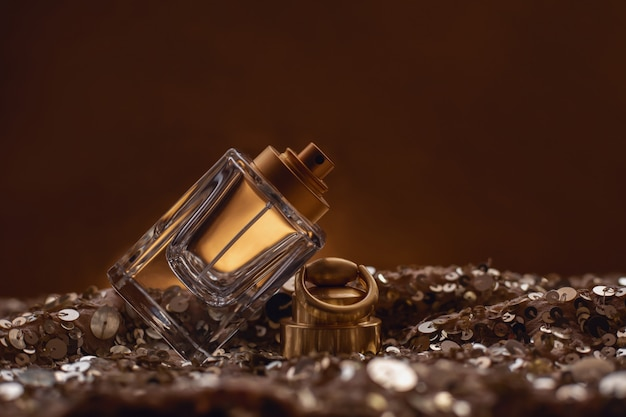 Perfume bottle on golden bokeh .
