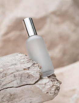 Perfume bottle on rocks arrangement
