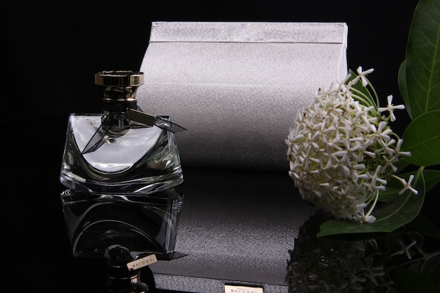 A perfume bottle with a black background