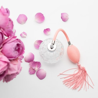 Perfume bottle with flowers. perfumery, cosmetics, fragrance collection.