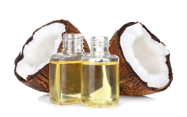 향수 병 및 흰색 바탕에 코코넛