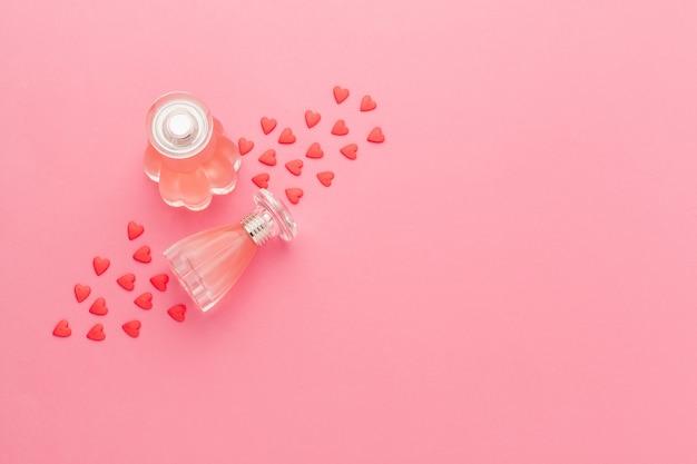 Perfume bottles on pink