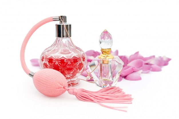 Perfume bottles with flower petals. perfumery, cosmetics, fragrance collection