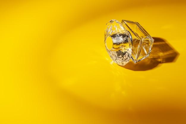 Perfume glass bottle on light yellow. eau de toilette